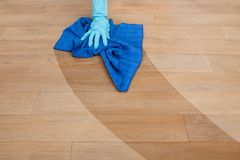Maid cleaning floor stock image