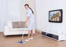 Maid cleaning floor with mop Royalty Free Stock Images