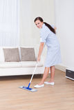 Maid Cleaning Floor With Mop Stock Photography