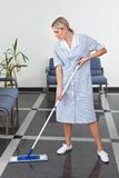 Maid cleaning the floor Royalty Free Stock Photography