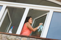 Maid cleaning windows Royalty Free Stock Photos