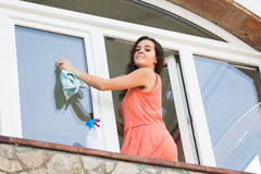Maid cleaning windows Royalty Free Stock Photography