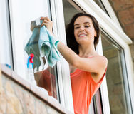 Maid cleaning windows Stock Photo