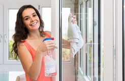 Maid cleaning windows Royalty Free Stock Images