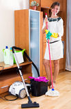 The maid cleans the house Stock Photo