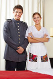 Maid and concierge in hotel room. Housekeeping maid and happy concierge in a hotel room Stock Photography