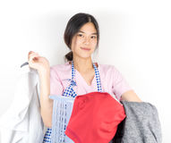 Maid is confidence in doing laundry. Housewife maid is confidence in doing laundry royalty free stock image