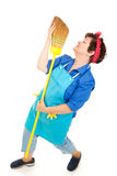 Maid Dancing with Broom Stock Image