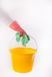 Maid holding bucket and cleaning cloth on white background Royalty Free Stock Image
