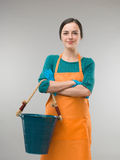 Maid holding cleaning bucket Royalty Free Stock Photos