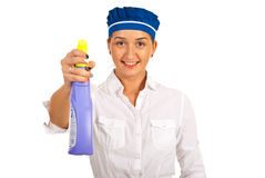 Maid holding cleaning product Stock Photography