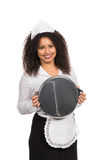 Maid is holding an empty tablet Royalty Free Stock Photo