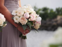 Maid of honor holding  Brides bouquet Stock Images