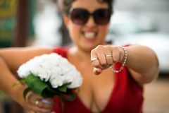 Maid of honour with wedding rings. Maid of honour holdings the weddings rings for her best friends wedding Stock Photo