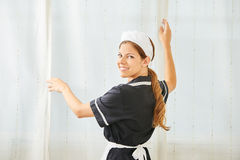 Maid in hotel room during housekeeping Stock Photo