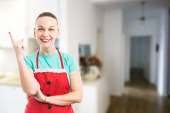 Maid or housekeeper rising index finger as great idea concept royalty free stock images