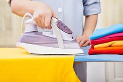 Maid ironing clothes Royalty Free Stock Photos