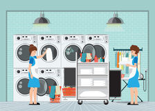Maid loading laundry washing machine with cloth. Royalty Free Stock Photos