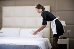 Maid Making Bed Royalty Free Stock Image