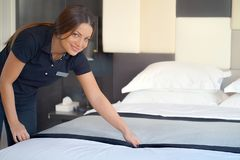 Maid Making Bed. In hotel room. Housekeeper Making Bed stock image