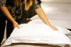 Maid Making Bed. Toning. Maid making bed in hotel room. Toning Stock Photos