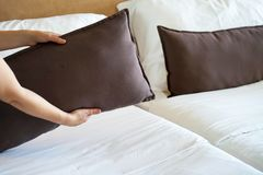 Maid Making Bed. In hotel room Royalty Free Stock Photo