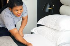Maid Making Bed. In hotel room royalty free stock photos