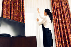 Maid Making Up A Hotel Room Stock Images