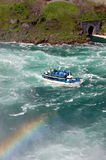 Maid of the Mist Niagara Falls. Maid of the Mist boat in Niagara Falls, with rainbow over water Royalty Free Stock Photos
