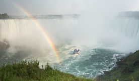 Maid of the Mist Niagara Falls. The boat known as the maid of the mist  at the base of the Canadian horseshoe falls with a rainbow next to it Royalty Free Stock Images