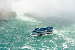 Maid of the Mist in Niagara Falls. TORONTO,CANADA-AUGU ST 21, 2014: Maid of the mist boat taking tourists to the Horseshoe fall in the Niagara River. The boat Stock Photography