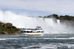 Maid of the Mist at Niagara Falls. With tourists visiting the waterfalls on the US side Stock Images