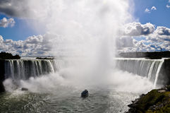 Maid of the mist sailing into Niagara Falls. Royalty Free Stock Photos