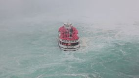 The Maid of the Mist tour boat at the Niagara Falls. Niagara Falls, Canada - Oct 15, 2017: The Maid of the Mist boat with tourists during a tour to the Horseshoe stock video