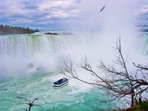 Maid of the mist : traveller boat travelling into Niangara Falls, Canada side (Horseshoe falls) Stock Images