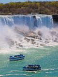 Maid of the mist : traveller boats in the river at Niangara Falls, American side (American falls) Royalty Free Stock Images