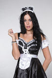 Maid posing flirty in uniform looking directly Stock Images
