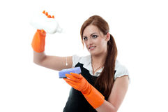 Maid pours the liquid on a sponge Stock Images