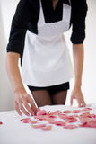 Maid Preparing Bed For Honeymooners Royalty Free Stock Photography