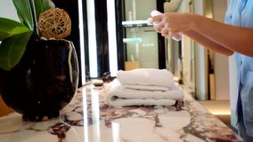 Maid puts towel in the hotel room
