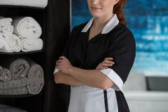 Maid satisfied with work. Close-up of self-confident maid satisfied with her work Stock Photos