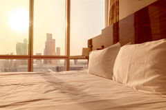 Maid-up bed in room Royalty Free Stock Images