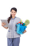 Maid using tablet touch pad Stock Photos