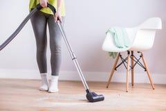 Maid vacuuming floor Stock Photos