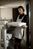 Maid At Work. Maid with housekeeping cart, in hotel Stock Image