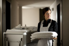 Maid At Work. Maid with housekeeping cart, in hotel Royalty Free Stock Photo
