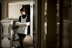 Maid At Work. Maid with housekeeping cart, in hotel Royalty Free Stock Photography