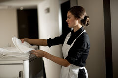 Maid At Work. Maid with housekeeping cart, in hotel Royalty Free Stock Photos