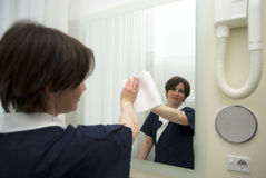Maid at work. Maid working in hotel room Royalty Free Stock Photography