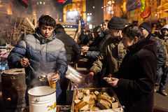 Maidan - activist giving soup and bread to protesters. Kiev, Ukraine, 22 December 2013: Maidan - activist giving soup and bread to protesters Stock Images